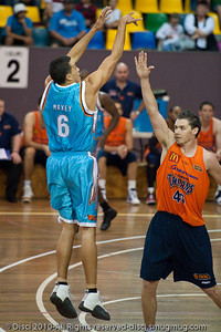 Bennett Davison shoots over Alex Loughton - Gold Coast Blaze v Cairns Taipans pre-season NBL basketball game, Saturday 18 September 2010, Carrara, Gold Coast, Australia.