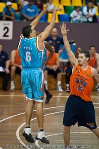 Bennett Davison shoots over Alex Loughton - Gold Coast Blaze v Cairns Taipans pre-season NBL basketball game, Saturday 18 September 2010, Carrara, Gold Coast, Australia.
