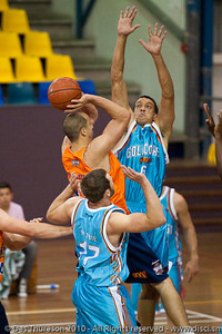 Dusty Rychart shoots under pressure from Bennett Davison - Gold Coast Blaze v Cairns Taipans pre-season NBL basketball game, Saturday 18 September 2010, Carrara, Gold Coast, Australia.