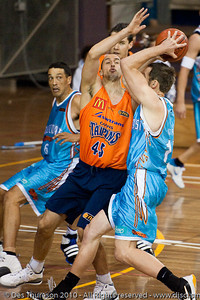 Dusty Rychart plays D on Anthony Petrie - Gold Coast Blaze v Cairns Taipans pre-season NBL basketball game, Saturday 18 September 2010, Carrara, Gold Coast, Australia.
