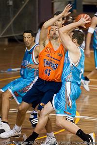 Dusty Rychart plays D on Anthony Petrie - Gold Coast Blaze v Cairns Taipans pre-season NBL basketball game, Saturday 18 September 2010, Carrara, Gold Coast, Australia.