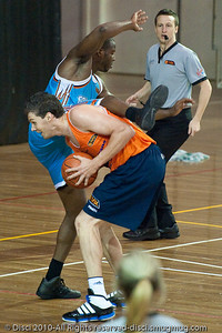"""Thump!"" - Alex Loughton's up-fake proves successful as he tempts the early jump, landing & foul from James Maye - Gold Coast Blaze v Cairns Taipans pre-season NBL basketball game, Saturday 18 September 2010, Carrara, Gold Coast, Australia."