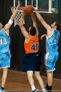 Anthony Petrie gets a hand to Alex Loughton's shot - Gold Coast Blaze v Cairns Taipans pre-season NBL basketball game, Saturday 18 September 2010, Carrara, Gold Coast, Australia.