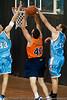 Anthony Petrie gets a hand to Alex Loughton's shot - Gold Coast Blaze v Cairns Taipans pre-season NBL basketball game, Saturday 18 September 2010, Carrara, Gold Coast, Australia.
