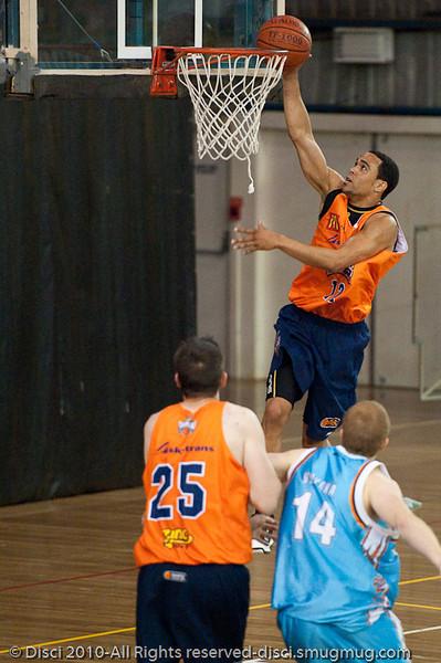 Daniel Dillon elevates - Gold Coast Blaze v Cairns Taipans pre-season NBL basketball game, Saturday 18 September 2010, Carrara, Gold Coast, Australia.