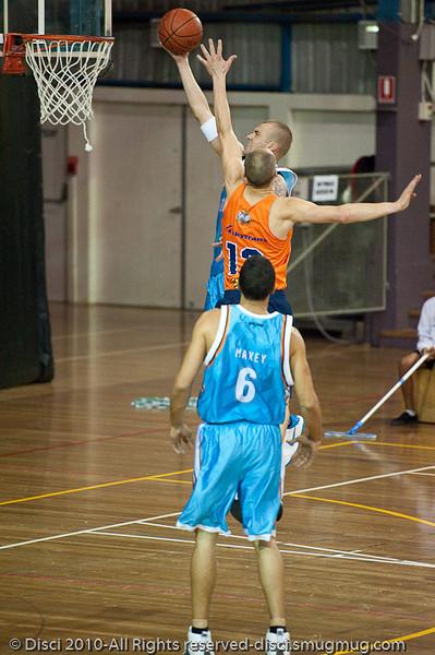 James Harvey  drives strong to the hoop - Gold Coast Blaze v Cairns Taipans pre-season NBL basketball game, Saturday 18 September 2010, Carrara, Gold Coast, Australia.