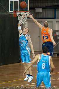 James Harvey  drives strong to the hoop - Gold Coast Blaze v Cairns Taipans pre-season NBL basketball game, Saturday 18 September 2010, Carrara, Gold Coast, Australia.