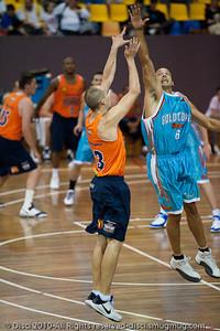 Bennett Davison pressures Phill Jones - Gold Coast Blaze v Cairns Taipans pre-season NBL basketball game, Saturday 18 September 2010, Carrara, Gold Coast, Australia.