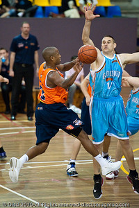 Ayinde Ubaka with the no-look dump pass - Gold Coast Blaze v Cairns Taipans pre-season NBL basketball game, Saturday 18 September 2010, Carrara, Gold Coast, Australia.