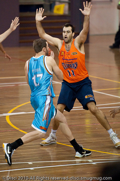 Anthony Petrie beats one 'big' and then meets the next: Ian Crosswhite - Gold Coast Blaze v Cairns Taipans pre-season NBL basketball game, Saturday 18 September 2010, Carrara, Gold Coast, Australia.
