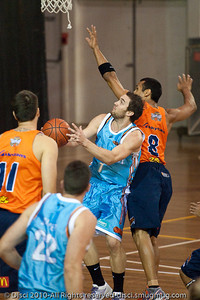 Adam Gibson drives strong to the hoop - Gold Coast Blaze v Cairns Taipans pre-season NBL basketball game, Saturday 18 September 2010, Carrara, Gold Coast, Australia.