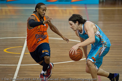 "Deba George puts the D on Chris ""Bubbles"" Goulding - Gold Coast Blaze v Cairns Taipans pre-season NBL basketball game, Saturday 18 September 2010, Carrara, Gold Coast, Australia."