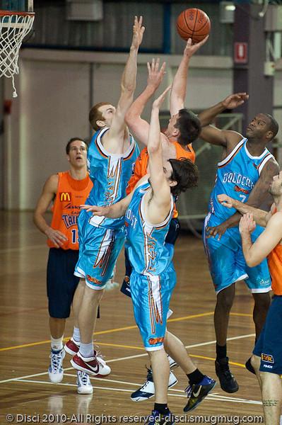 Dean Brebner goes inside against Tom Garlepp - Gold Coast Blaze v Cairns Taipans pre-season NBL basketball game, Saturday 18 September 2010, Carrara, Gold Coast, Australia.