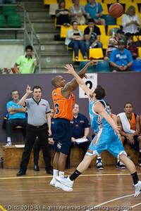 Adam Gibson puts the leap on Ayinde Ubaka -Gold Coast Blaze v Cairns Taipans pre-season NBL basketball game, Saturday 18 September 2010, Carrara, Gold Coast, Australia.