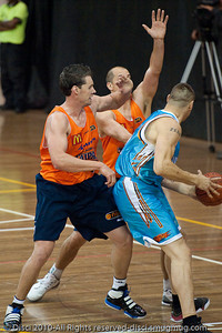 Pero Vasiljevic is stopped by the Cairns double-team of Alex Loughton & Dusty Rychart - Gold Coast Blaze v Cairns Taipans pre-season NBL basketball game, Saturday 18 September 2010, Carrara, Gold Coast, Australia.
