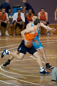 Pero Vasiljevic puts the pressure on Alex Loughton - Gold Coast Blaze v Cairns Taipans pre-season NBL basketball game, Saturday 18 September 2010, Carrara, Gold Coast, Australia.
