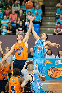 The Gold Coast's Bennett Davison jumps against The Cairns Taipans' recruit Alex Loughton - Gold Coast Blaze v Cairns Taipans pre-season NBL basketball game, Saturday 18 September 2010, Carrara, Gold Coast, Australia.