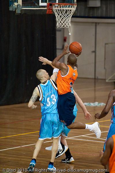 Ayinde Ubaka goes strong to the hoop - Gold Coast Blaze v Cairns Taipans pre-season NBL basketball game, Saturday 18 September 2010, Carrara, Gold Coast, Australia.
