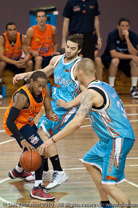Deba George is weary of the attention of Adam Gibson & James Harvey - Gold Coast Blaze v Cairns Taipans pre-season NBL basketball game, Saturday 18 September 2010, Carrara, Gold Coast, Australia.