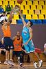 Bennett Davison closes-out to Taipan's veteran Aaron Grabau's shot, as Deba George looks on - Gold Coast Blaze v Cairns Taipans pre-season NBL basketball game, Saturday 18 September 2010, Carrara, Gold Coast, Australia.