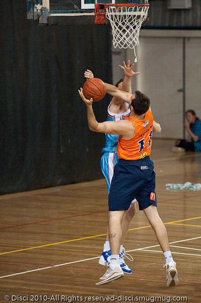 Ian Crosswhite is pressured by Stephen Hoare - Gold Coast Blaze v Cairns Taipans pre-season NBL basketball game, Saturday 18 September 2010, Carrara, Gold Coast, Australia.