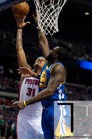 Dec 5, 2012; Auburn Hills, MI, USA; Golden State Warriors small forward Draymond Green (23) attempts to block Detroit Pistons power forward Charlie Villanueva (31) during the fourth quarter at The Palace.The Warriors defeated the Pistons 104-97. Mandatory Credit: Tim Fuller-USA TODAY Sports