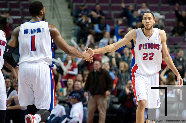 Dec 5, 2012; Auburn Hills, MI, USA; Detroit Pistons small forward Tayshaun Prince (22) high fives center Andre Drummond (1) during the fourth quarter against the Golden State Warriors at The Palace.The Warriors defeated the Pistons 104-97. Mandatory Credit: Tim Fuller-USA TODAY Sports