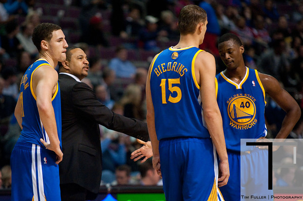 Dec 5, 2012; Auburn Hills, MI, USA; Golden State Warriors head coach Mark Jackson (second from left) talks to shooting guard Klay Thompson (11) power forward Andris Biedrins (15) and small forward Harrison Barnes (40) during the third quarter against the Detroit Pistons at The Palace.The Warriors defeated the Pistons 104-97. Mandatory Credit: Tim Fuller-USA TODAY Sports
