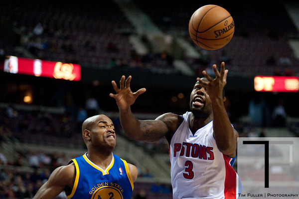 Dec 5, 2012; Auburn Hills, MI, USA; Detroit Pistons point guard Rodney Stuckey (3) loses control of the ball while being guarded by Golden State Warriors point guard Jarrett Jack (2) during the fourth quarter at The Palace.The Warriors defeated the Pistons 104-97. Mandatory Credit: Tim Fuller-USA TODAY Sports
