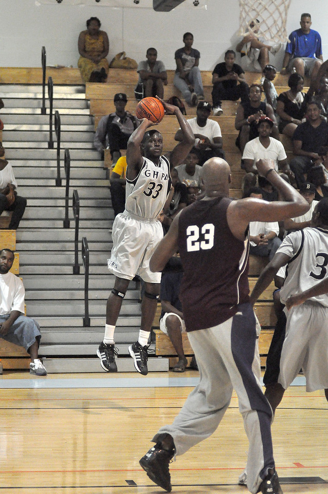 Adrien Satchell takes a jumper in Sunday nights game. (7/18/2010)