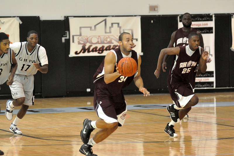 Raymond Evans pushes the fastbreak during Sunday nights game. (7/18/2010)