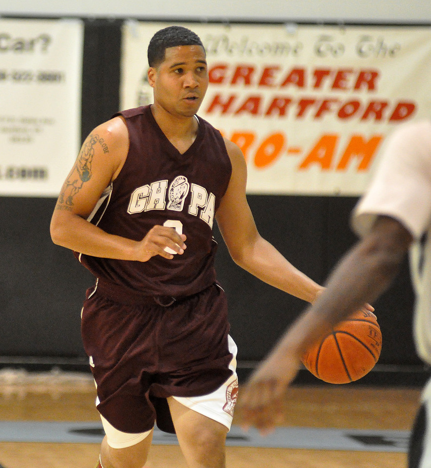 Mark Jones brings the ball down the court. (7/18/2010)