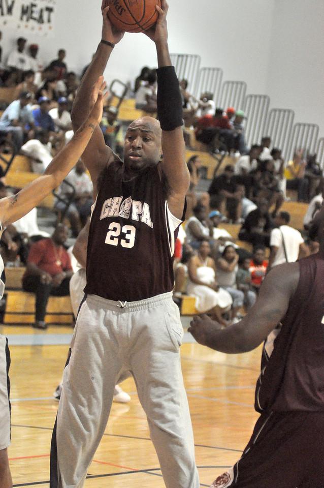 Vin Baker of Simonize grabs a rebound in Sunday nights game. (7/18/2010)