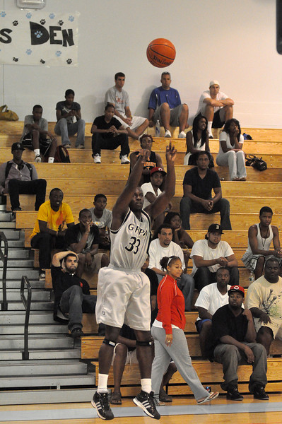 Adrien Satchell throws up a jumper in Sunday nights game against Simonize.(7/18/2010)