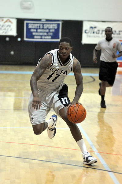 Kieth Cothran dribbles toward the hoop.(7/18/2010)
