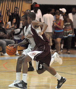 Steve Samuels brings the ball up the court while closely guarded. (7/18/2010)