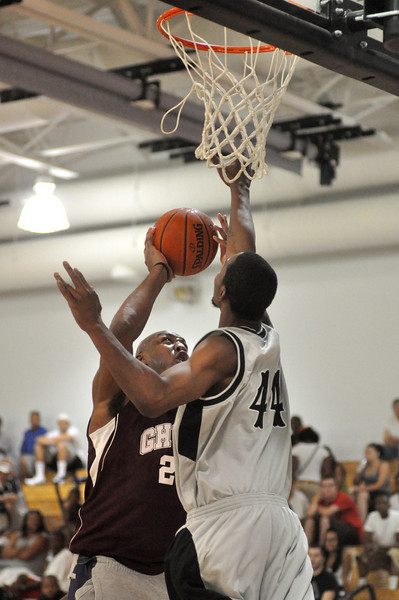 Vin Baker going strong to the hoop while Malik Chapmin defends. (7/18/2010)