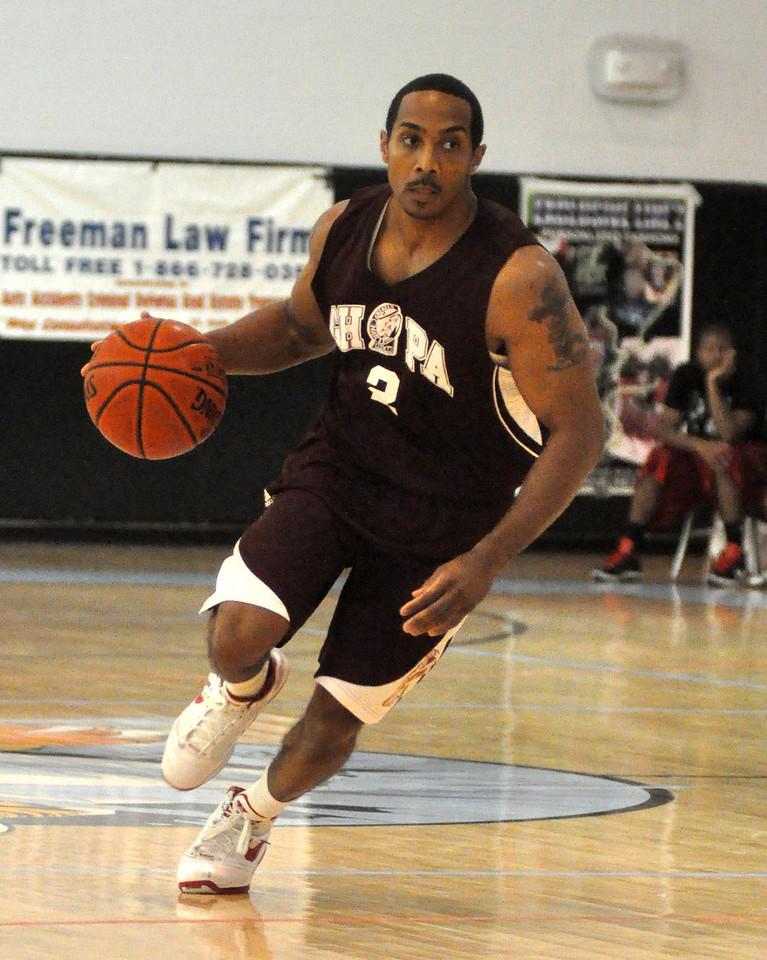 Matt Turner dribbles up the court. (7/18/2010)