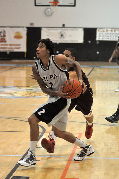 PJ Santavenere drives to the hoop in Sunday nights game against Harte Nissan.