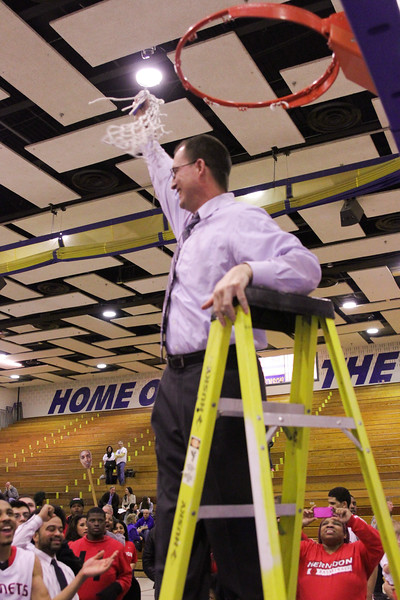 Hornets head coach Gary Hall making the final cut to the net after winning the 2012-13 Concorde District title.