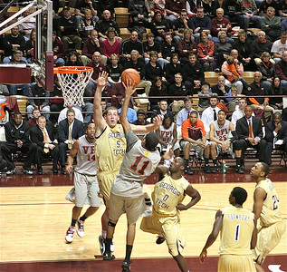 Erick Green shoots a left handed shot against the six-foot-eleven center of Georgia Tech.