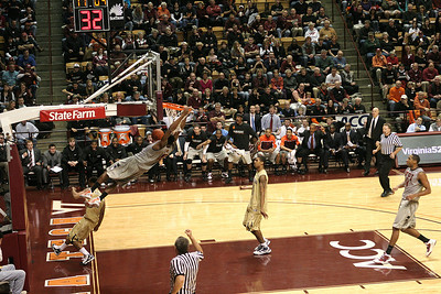 Jeff Allen takes an outlet and without dribbling goes in for the dunk as players on the bench celebrate.  Shot 5 of 5.