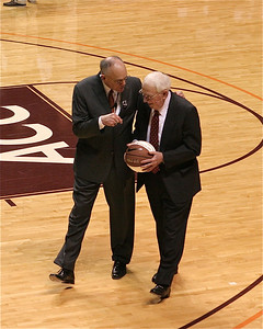 Coach Charlie Moir (with the basketball) returns to the Cassell for honors.