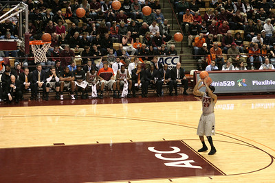 The Arc of Delaney!  Malcolm Delaney is an 88% free throw shooter here shooting one of about six technical fouls against Georgia Tech, hence the open lane.  My high school basketball buddies and I called this loopage.    I captured several shots all the way to the basket and combined them to show the full arc of the basketball from Delaney to the net.