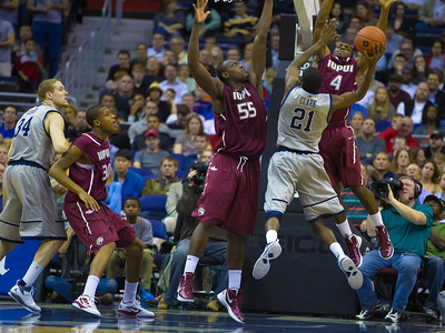 Hoyas' Jason Clark shoots over IUPUI's Christian Siakam.