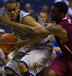 Markel Starks of Georgetown is guarded by Ian Chiles of IUPUI