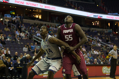Hoyas Henry Sims boxes out Jaguar's Christian Siakam