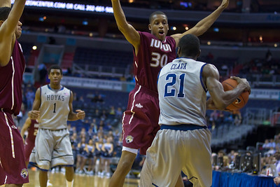 Hoyas' Jason Clark is guarded by IUPUI's Donovan Gibbs