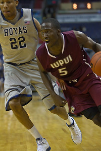 IUPUI's Alex Young drives on Hoyas' Otto Porter