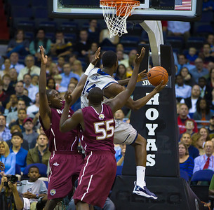 Hoyas' Henry Sims goes up against Jaguar's Markel Starks and Christian Siakam